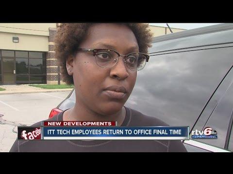 ITT Tech employees collect things from closing school