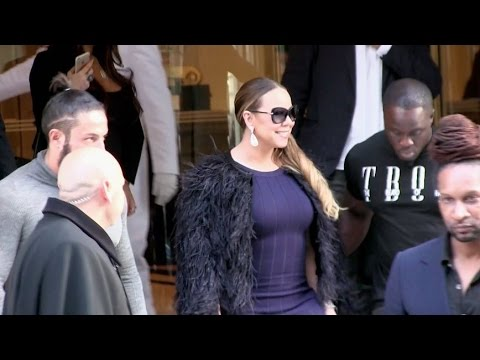 EXCLUSIVE: Automatic smile Mariah Carey comes out of her hotel in Paris