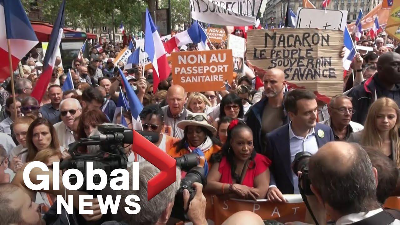 Download COVID-19: Thousands stage Paris protest against Macron's health pass