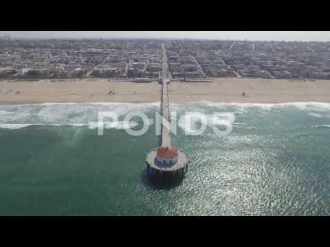 4K Static Aerial View Of Manhattan Beach Shore And Pier