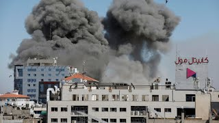 Israeli air strike flattens Gaza building housing AP, Al-Jazeera as violence spirals