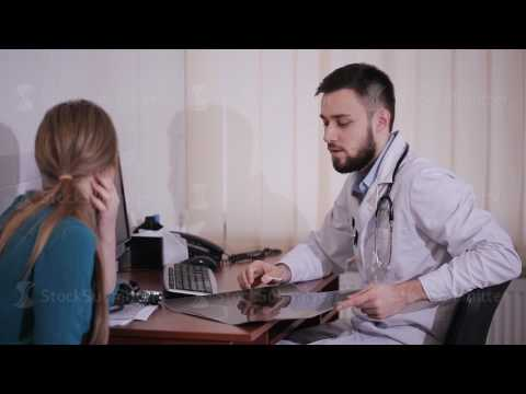 Male doctor consults his patient in the office