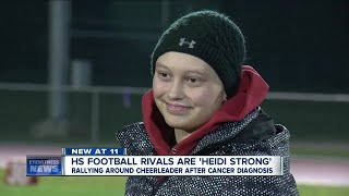 Football rivals put aside differences to support cheerleader fighting cancer