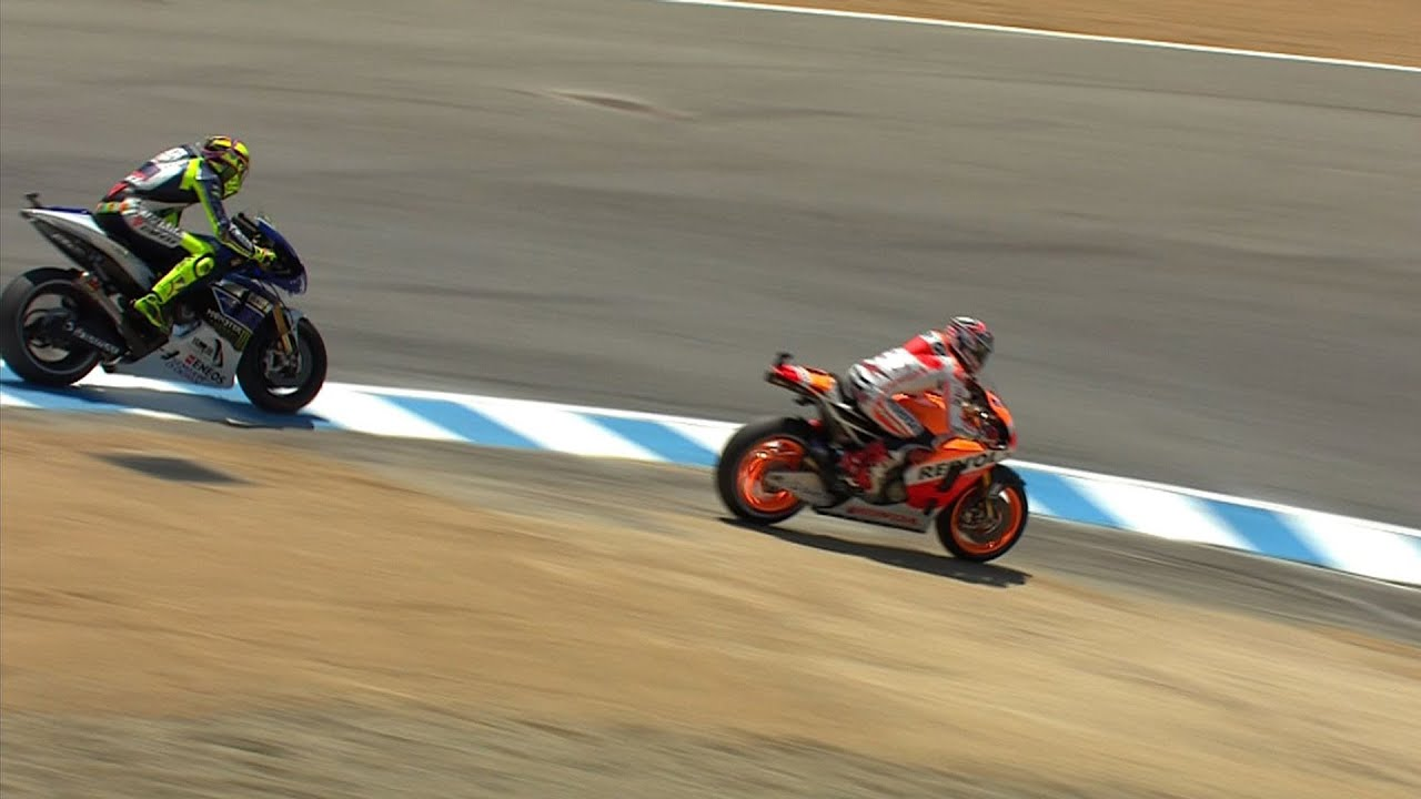 Marquez puts one over Rossi at the Corkscrew - YouTube