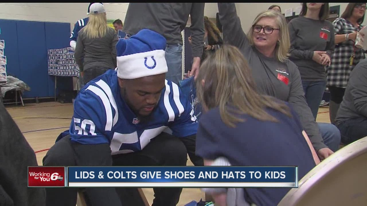 LIDS and Colts give shoes and hats to kids at Hawthorne Elementary School 6bd00928b