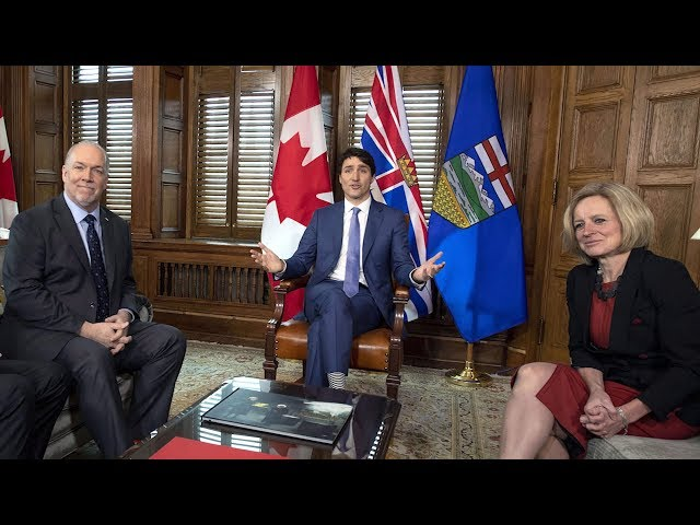 The premiers of B.C. and Alberta met with the prime minister in Ottawa to discuss the dispute over the planned Trans Mountain pipeline expansion. Justin Trudeau says negotiations are underway with Kinder Morgan to see construction go ahead. (The Canadian Press)