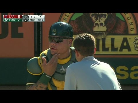 LAA@OAK: Maxwell gets hit by foul, stays in game