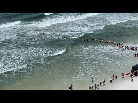 Rob and Hilary - Highs & lows - Human chain forms to rescue swimmer in PCB
