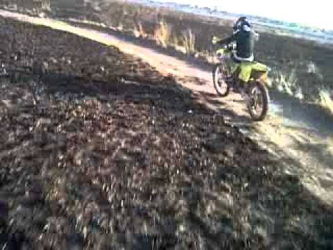 12 year old riding a suzuki rm250