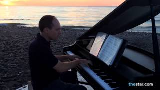 James Levac, hauled his solar-powered grand piano to the Boardwalk before sunrise much to the delight of joggers and dog walkers who took in the impromptu concert.