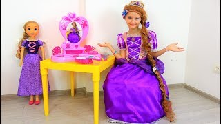 Polina turned into Princess Rapunzel and plays with a new doll