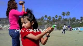 Fly a kite train, paint a rainbow in the sky
