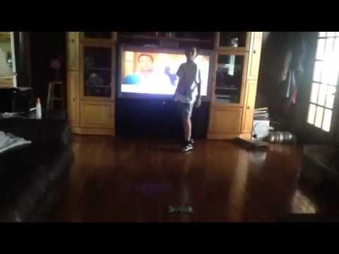 Kid jumps far length and falls twice