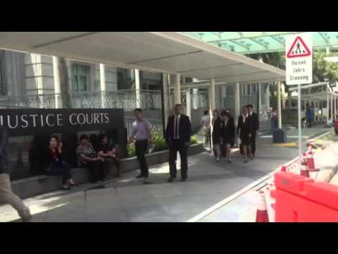 Amos Yee's lawyer Alfred Dodwell arriving at State Courts
