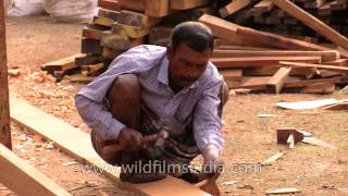 Carving Wood For Making A Boat In West Bengal, India