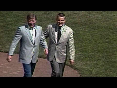 Mickey Mantle, joined by Roger Maris, tosses first pitch