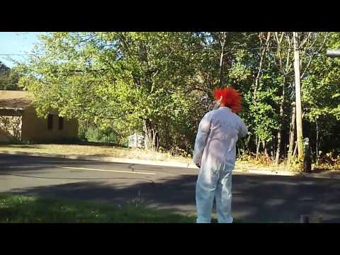 Clown waits for kids to get off school bus