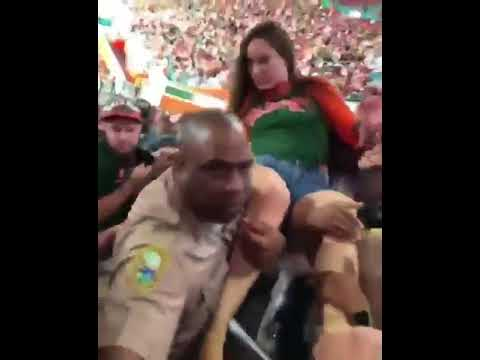 Miami female fan slapped by cop