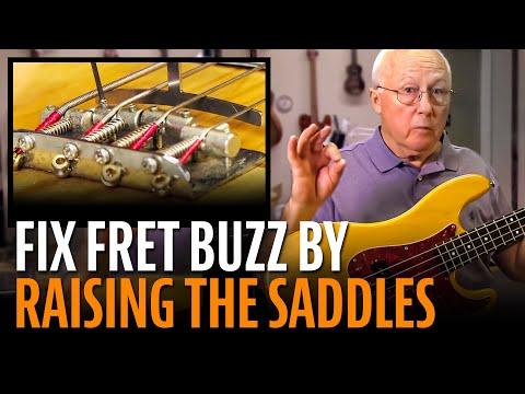 Fixing fret buzz: raising the saddles