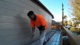 Rolling HardiPlank cladding with small roller