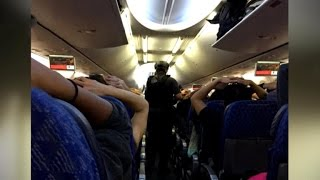 SWAT team searches plane in Miami airport security scare