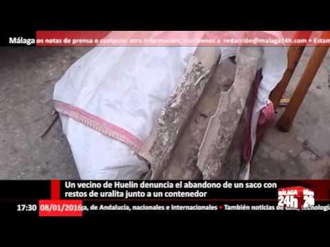 Vecino de Huelin graba restos de uralita en un contenedor del barrio