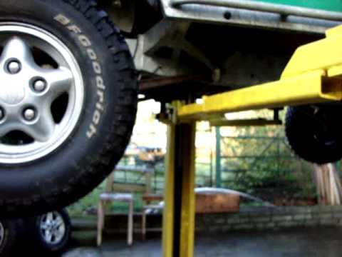 LRM Green Machine Land Rover on Dunlop 2 post lift / ramp