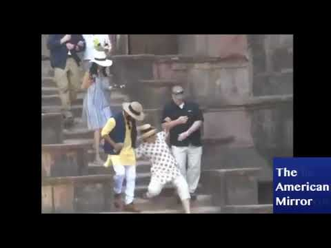 Hillary Clinton Nearly Falls Down Stairs In India Twice (Benny Hill tune added)