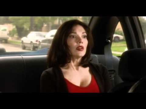Laura Elena Harring hot cleavage  in red tshirt in