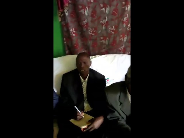 Brother Alfred Testifying to Elders at GMFC Working Faith Fellowship Moi's Bridge Kenya