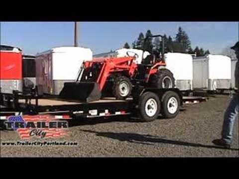 Loading A Tractor On A Pj Tilt Trailer Youtube