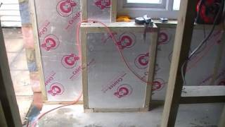 Studwork And Insulation In Garage Conversion.wmv
