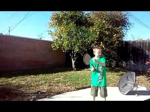 Kid breaks phone while doing trickshot