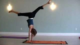yoga teachers practice handstand and backbend variations