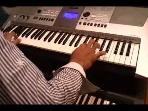 ek jibone playing keyboard instrument