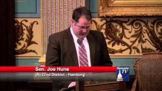 Senator Joe Hune pays tribute to Congressman Mike Rogers in Senate Resolution 212