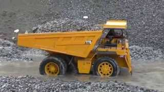 RC Caterpillar 777D big mining dump truck in Action