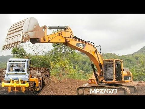 Large Excavator And Bulldozer Working