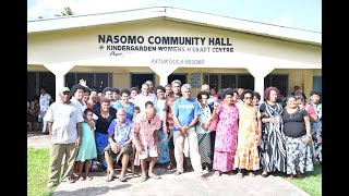 Fijian Minister for Lands and Mineral Resources hands out cheques for 100 landowners in Nasomo.