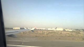 AIR ARABIA TAKE OFF FROM SHARJAH INTERNATIONAL AIRPORT - HD.