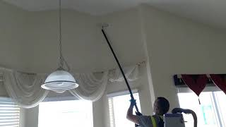 Vacuum and removing dust from walls
