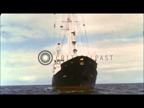 Oceanic survey ship underway in ocean. Explosive charges detonated underwater HD Stock Footage