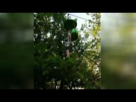 Watch Girl Fall from Six Flags Sky Ride!  Caught by Park Visitors!