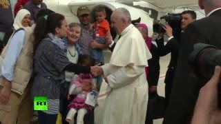 Pope Francis brings 12 Syrian refugees to Vatican