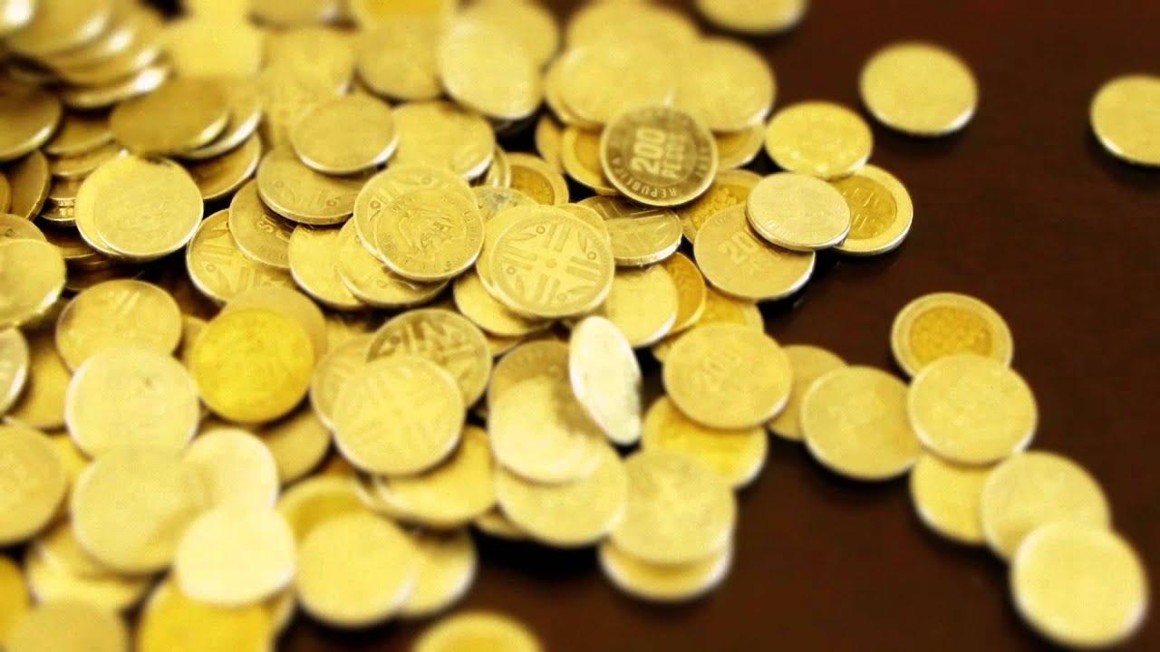 #2829, Muchas Moneda Cayendo Sobre Una Mesa [Efecto
