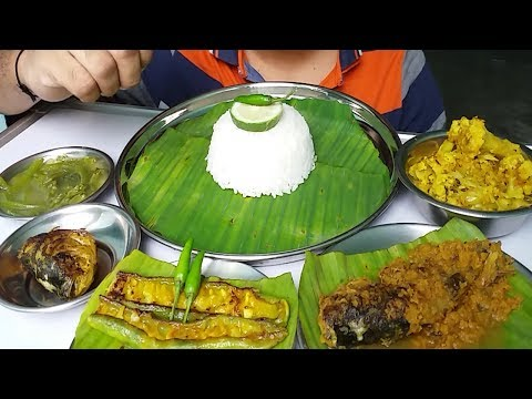 healthy food vegetables and fish curry eating with rice ( Indian Bengali Food)