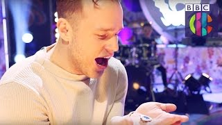 Olly Murs reacts to getting his Blue Peter Badge | CBBC