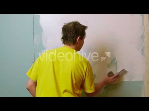 Construction Worker Applying Plaster on a Drywall - Stock Footage | VideoHive 10227504