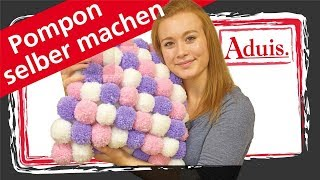 Flauschiges Pomponkissen