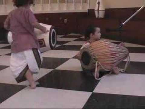 Rakta and Vraja doing Bhajans